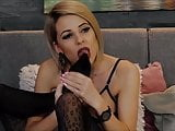 blond in black patterned pantyhose lick her nylon feet