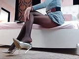 Sexy Girl With Beautiful Long Legs In Pantyhose
