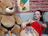 Cute Babe Fucks With Lustful Bear in Strap-on