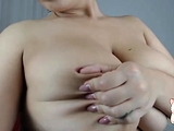 Lily toys close by her juicy boobs inside the kitchen