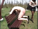 Outdoor BDSM spanking and humiliation