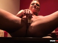 Busty babe uses a banana on her slit