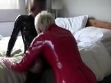 Latex clad lesbo strapon fucks and fingers fetish hoes pussy