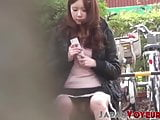 Japanese chick caught with visible panties on hidden cam
