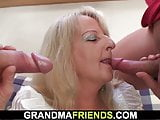 Boozed blonde granny takes two big cocks from both sides