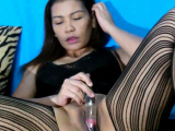 Asian chick loves her small glass dildo