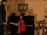 Vintage girl caned on the piano